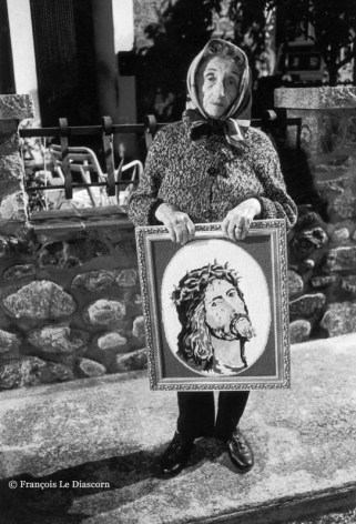 Ref CHRISTUS 6 – Elderly woman holding picture of Christ during an Easter procession, Arles-sur-le Tech, France