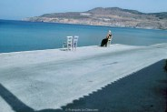 REF BLUE GREECE 14 – Woman sitting by the sea, island of Lesbos