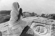 Ref India 12 – Jain woman praying to a holy footprint. Sravana Belgola