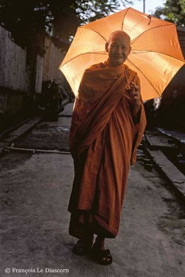 Ref BUDDHA 10 – Portrait of a monk with an orange umbrella, Luang Prabang, Laos