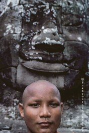Ref BUDDHA 13 – Portrait of a monk and a sculpted head, Bayon Temple, Angkor, Cambodia