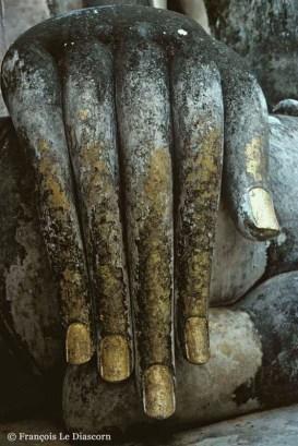 Ref BUDDHA 2 – Hand of Buddha, Wat Si Chum Temple, Buddhist ruins at Sukhothai, Thailand